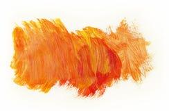 Paint. Orange paint texture on plain background Stock Photos