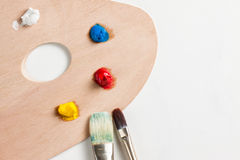 Paint and paint brushes Stock Photos
