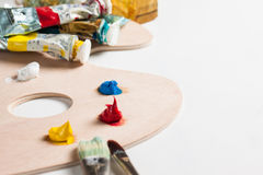 Paint and paint brushes. Oil paint tubes, paint brushes and paint on a pallette Stock Images
