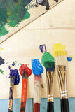 Paint and Paintbrushes Stock Images