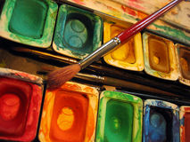 Paint Palette. Pallette of colourful paints with paint brushes stock photo