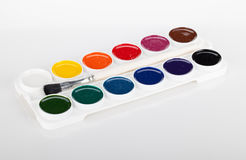 Paint palette with brush Stock Images
