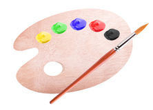 Paint palette and brush Royalty Free Stock Image