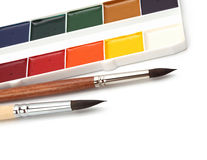 Paint palette and brushes Stock Photos