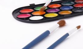 Paint palette and brushes Stock Images