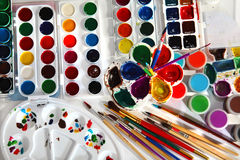 Paint palettes and brushes Royalty Free Stock Photography