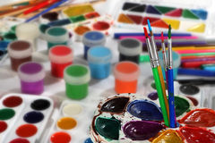 Paint palettes and brushes. Selective focus Royalty Free Stock Photography