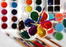 Paint palettes and brushes. Selective focus Stock Image