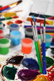 Paint palettes and brushes. Selective focus Royalty Free Stock Photos