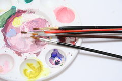 Paint Pallet. Paint brushes resting on a paint pallet Royalty Free Stock Image