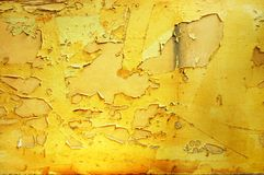 Paint peeling from a decaying wall. Stock Photos