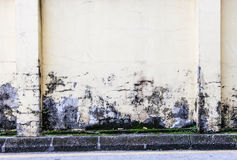 Paint peeling off dirty concrete wall Royalty Free Stock Photography