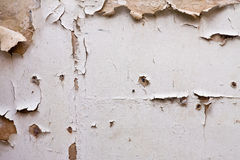 Paint peeling off plaster wal Stock Photo