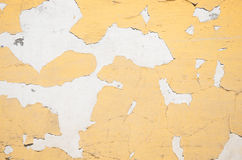 Paint peeling off a white wall. White cracked paint peeling off a dirty white wall background Stock Photo