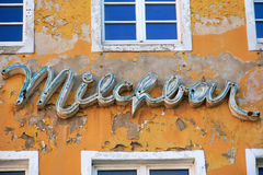 Paint peeling old house facade in Germany Stock Image