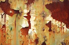 Corrosion. Paint peeling from rusty metal plate Royalty Free Stock Photography