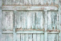 Paint-peeling wooden old door texture Stock Photo