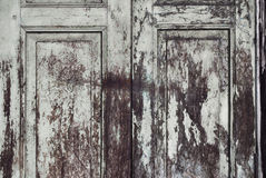 Paint peeling wooden old door texture Stock Image
