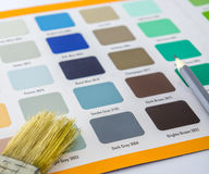 Paint picker book with paint brush and a pencil with abstract style Stock Photo