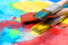 Paint a picture on a paper with a brush Stock Images
