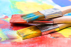 Paint a picture on a paper with a brush Stock Image