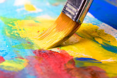 Paint a picture on a paper with a brush Royalty Free Stock Image