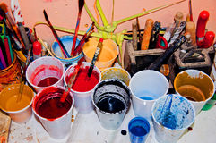 Paint in plastic cups. Plastic cups with paint on table in art shop Royalty Free Stock Photo