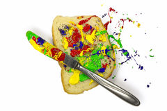 Paint playfully spread on the bread Royalty Free Stock Images