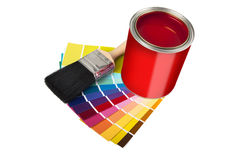 Paint pot and multi coloured swatches Stock Photography