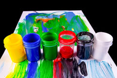 Paint pots in assorted colors royalty free stock image