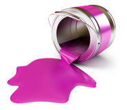 Paint is poured from a can Stock Photos