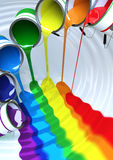 Paint poured to make a rainbow river. A river of colors to make a rainbow Royalty Free Stock Image