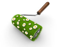 Paint roller. Covered with grass and daisy flowers Stock Photos