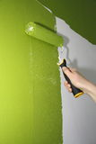 Paint roller. On a wall stock image