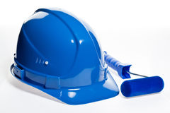 Paint roller and blue hardhat Royalty Free Stock Image