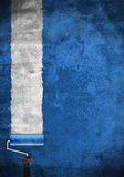 Paint roller with blue paint on white wall. Easy edit, template, card Royalty Free Stock Photography
