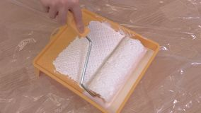 Paint roller brush close up. In room stock video