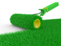 Paint roller brush with grass Stock Image