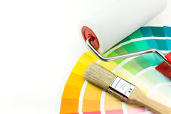 Paint roller and brush over color Stock Images