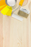 Paint roller, brush and paint can with color samples Royalty Free Stock Photo