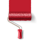 Paint roller brush with red paint track Royalty Free Stock Photos