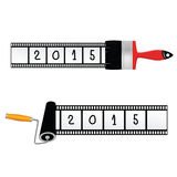 Paint roller and brush 2015 year. Paint roller and brush with film for 2015 year Stock Image