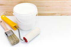 Paint roller and brushes with cans Royalty Free Stock Photos