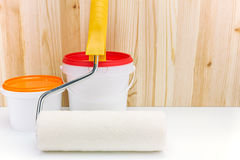 Paint roller with cans of paint Royalty Free Stock Photos