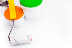 Paint roller with cans on white background Stock Photography