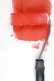Paint roller decorating wall Stock Photo