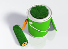 Paint roller and a grassy colored pot. A grassy paint roller rests to a uncovered pot with its orange handle, and you can see some green lawn that appears from Royalty Free Stock Photos