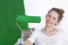 Paint roller with green color Royalty Free Stock Photography