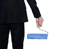 Paint roller in man hand Stock Photos