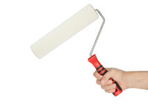 Paint roller in man's hand Royalty Free Stock Images